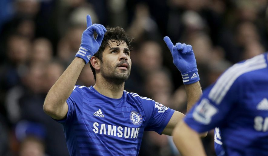 Chelsea's Diego Costa celebrates scoring his side's second goal during the English Premier League soccer match between Chelsea and West Ham at Stamford Bridge stadium in London, Friday, Dec. 26, 2014.  (AP Photo/Matt Dunham)