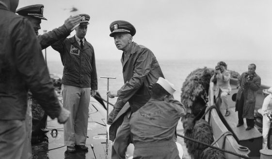 Rear Adm. Hyman G. Rickover, father of nuclear powered submarines, boards the USS Nautilus from the Navy Tug 534 in the Narrows below Brooklyn, New York on August 25, 1958. Cdr. William Anderson, head showing at left, awaits to greet the admiral aboard the U.S. Navy's first nuclear sub. Anderson is skipper of the Nautilus. Saluting at left center is Lt. Donald P. Hall, gunnery officer of the Nautilus. The craft returned earlier from 4-month voyage. (AP Photo/Pool)
