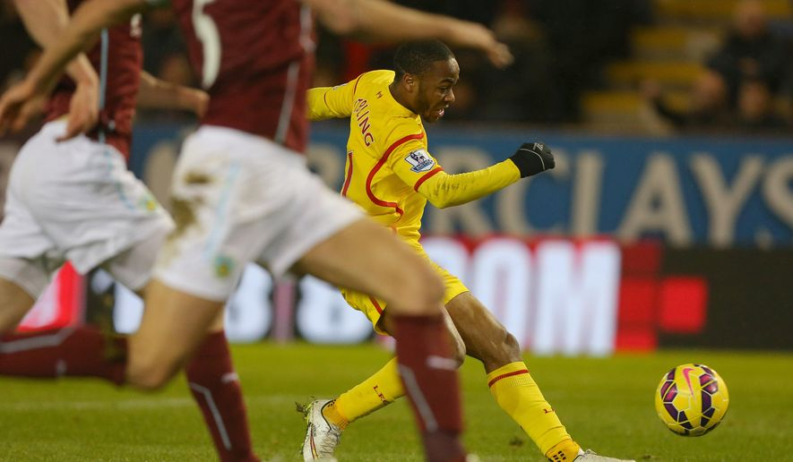Liverpool's Raheem Sterling scores during the Enlgish Premier League soccer match between Liverpool and Burnley at Turf Moor, Burnley, England, Friday, Dec. 26, 2014. (AP Photo/Dave Thompson, PA Wire)    UNITED KINGDOM OUT     -    NO SALES     -    NO ARCHIVES