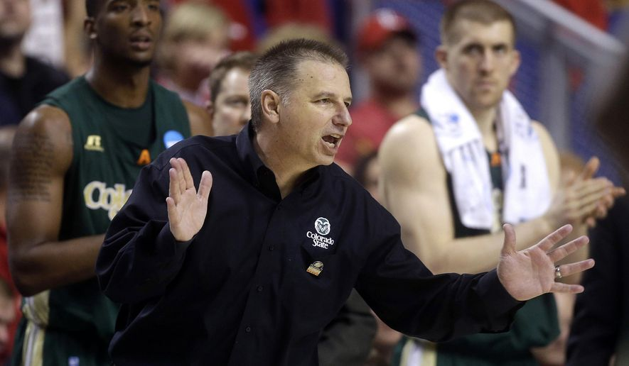 FILE - In this March 23, 2014, file photo, Colorado State Rams head coach Larry Eustachy directs his players during the second half against Louiville in a third-round NCAA college basketball tournament game game in Lexington, Ky. Eustachy has the Rams is off to a quick start this season.  (AP Photo/John Bazemore, File)