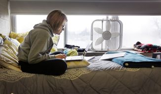 In this Dec. 9, 2014 photo, Adrian College student Abby Slusher studies in her dorm  in Adrian, Mich.  (AP Photo/Carlos Osorio) **FILE**