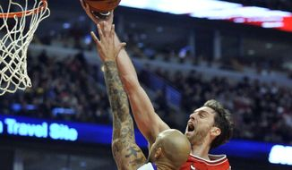 Chicago Bulls' Pau Gasol (16) goes up for a shot against Los Angeles Lakers' Robert Sacre (50) during the second half of an NBA basketball game in Chicago, Thursday, Dec. 25, 2014. (AP Photo/Paul Beaty)