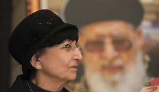 Adina Bar-Shalom attends a Shas party news conference in Bnei Brak near Tel Aviv, Israel, in this Dec., 14, 2014, file photo. In the background is a photo of her late father rabbi Ovadia Yosef, a longtime spiritual leader of the Shas party. (AP Photo/Shlomi Cohen)
