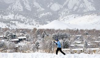 Denver, with its natural beauty, is considered one of the best places to start a new romance. (AP Photo/Brennan Linsley)
