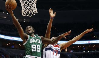 Boston Celtics forward Jae Crowder (99) shoots the ball in front of Washington Wizards guard Garrett Temple (17) in the second half of an NBA basketball game, Saturday, Dec. 27, 2014, in Washington. The Wizards won 101-88. (AP Photo/Alex Brandon)
