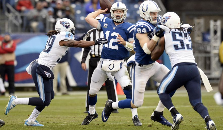 Indianapolis Colts quarterback Andrew Luck (12) passes as he is pressured by Tennessee Titans safety Daimion Stafford (39) and linebacker Quentin Groves (53) in the first half of an NFL football game Sunday, Dec. 28, 2014, in Nashville, Tenn. (AP Photo/Mark Zaleski)