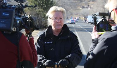 Sgt. Margaret Bentzen of the Flagstaff, Ariz. police department, speaks during a news conference, Saturday, Dec. 27 2014 on Clay Avenue near where  Flagstaff police officer Tyler Stewart was involved in a fatal shooting. According to the Flagstaff police department Robert W. Smith, 28, of Prescott, Ariz. opened fire on Stewart when he was responding to a domestic violence complaint before taking his own life. (AP Photo/The Arizona Daily Sun, Jake Bacon)