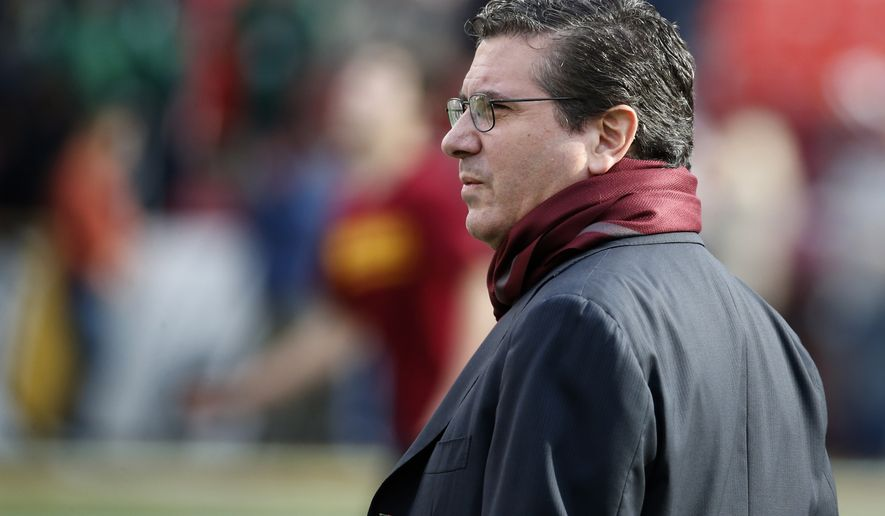 Washington Redskins owner Daniel Snyder watches the team warm up before an NFL football game against the Dallas Cowboys in Landover, Md., Sunday, Dec. 28, 2014. (AP Photo/Alex Brandon)