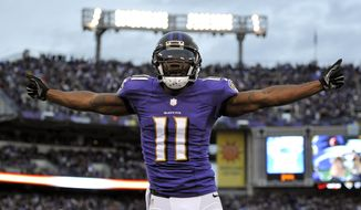 Baltimore Ravens wide receiver Kamar Aiken celebrates after scoring a touchdown in the second half of an NFL football game against the Cleveland Browns, Sunday, Dec. 28, 2014, in Baltimore. Baltimore won 20-10. (AP Photo/Gail Burton)