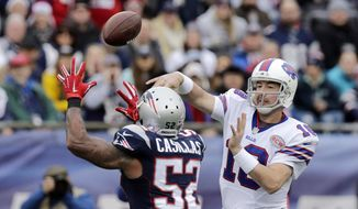 Buffalo Bills quarterback Kyle Orton (18) passes against New England Patriots linebacker Jonathan Casillas (52) in the first half of an NFL football game Sunday, Dec. 28, 2014, in Foxborough, Mass. (AP Photo/Charles Krupa)