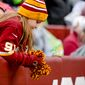 A young fan shows dejection as the Washington Redskins play the Dallas Cowboys the at FedExField, Landover, Md., Sunday, December 28, 2014. (Andrew Harnik/The Washington Times)