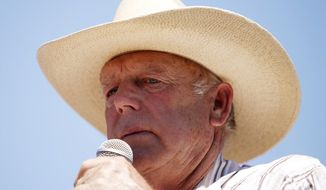 Nevada rancher Cliven Bundy continues to pasture his cattle on federal lands eight months after an armed standoff with authorities. (Associated Press)