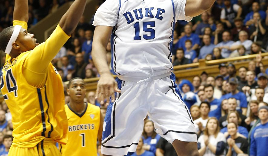 Duke's Jahlil Okafor (15) goes to the basket against Toledo's J.D. Weatherspoon, left, as Toledo's Jonathan Williams (1) looks on during the first half of an NCAA college basketball game Monday, Dec. 29, 2014 in Durham, N.C. (AP Photo/Ellen Ozier)