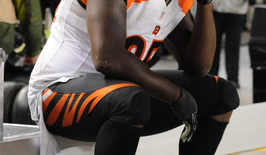Cincinnati Bengals defensive end Wallace Gilberry sits on the bench during the Pittsburgh Steelers' 27-17 win in an NFL football game, Sunday, Dec. 28, 2014, in Pittsburgh. The win gave the Steelers the AFC North title. (AP Photo/Don Wright)