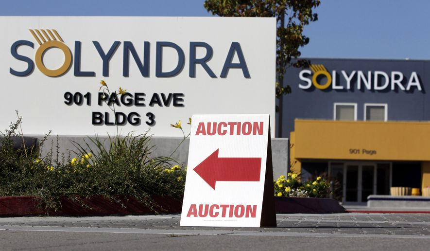 In this Oct. 31, 2011, file photo, an auction sign sits on a curb outside bankrupt Solyndra headquarters in Fremont, Calif. (AP Photo/Paul Sakuma, File)