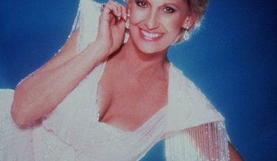 6. Stand By Your Man by Tammy Wynette - Tammy Wynette is shown in November 1986. (AP Photo)