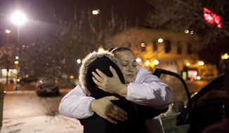 In this Jan 25, 2012 photo, Joy Friedman hugs a woman named Lisa who was working as a prostitute in Minneapolis. Friedman is a women's programs manager for Breaking Free, a St. Paul based nonprofit that helps women who want to leave the sex trade. Minnesota has become a national model for combating sex trafficking, particularly with its investment of state funds to support the victims. (AP Photo/The Star Tribune, Jeff Wheeler)