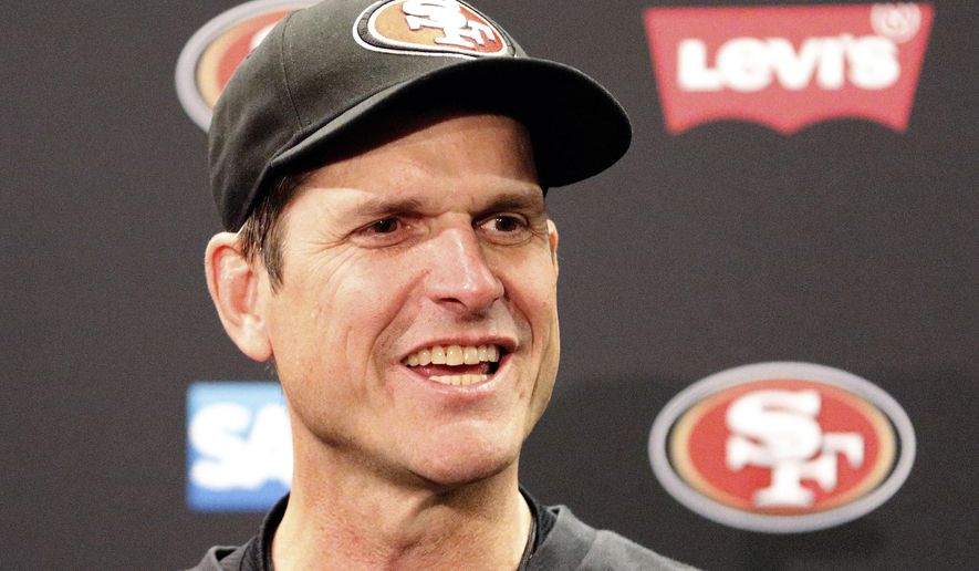 San Francisco 49ers head coach Jim Harbaugh speaks at a news conference after the 49ers defeated the Arizona Cardinals 20-17 in an NFL football game in Santa Clara, Calif., Sunday, Dec. 28, 2014. (AP Photo/Tony Avelar)