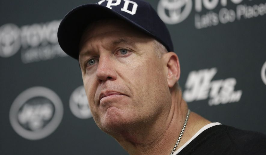 New York Jets head coach Rex Ryan listens to a questions during a news conference following an NFL football game against the Miami Dolphins, Sunday, Dec. 28, 2014, in Miami Gardens, Fla. The Jets won 37-24. (AP Photo/Lynne Sladky)