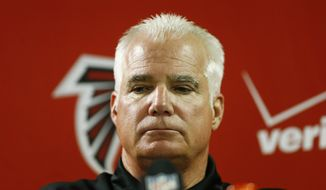 In this Sunday, Dec. 28, 2014 photo, Atlanta Falcons head coach Mike Smith speaks at a news conference after the second half of an NFL football game against the Carolina Panthers, in Atlanta. On Monday, Dec. 29, 2014, the Atlanta Falcons fired Smith, one day after the end of his second straight losing season. (AP Photo/John Bazemore)