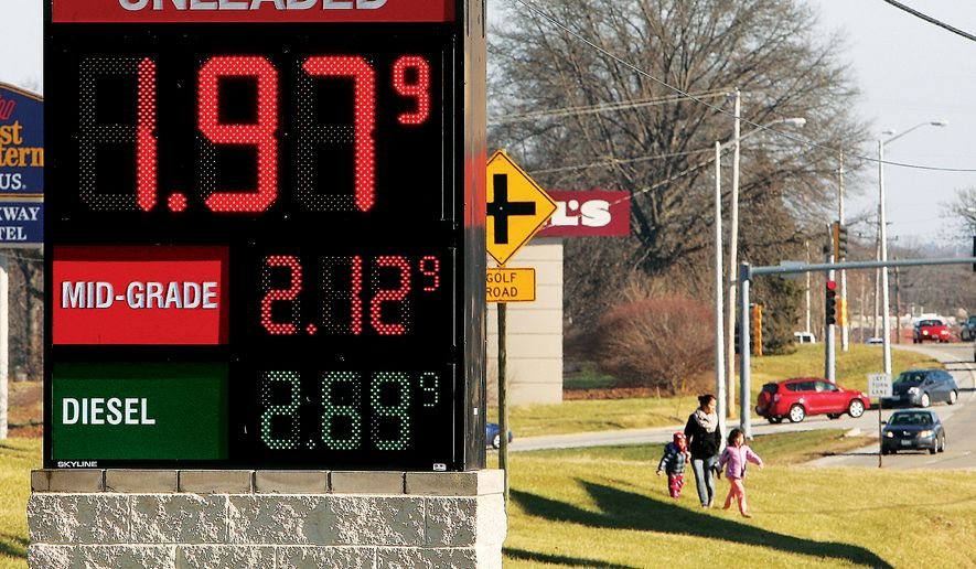 Unleaded gasoline is advertised below two dollars per gallon at the Alton Shop n Save gas station on the Homer Adams Parkway in Alton, Ill. on Monday, Dec. 29, 2014. Crude oil futures prices ended lower Monday on the New York Mercantile Exchange. The near-month contract for the benchmark grade fell $1.12 -- closing at $53.61 a barrel. (AP Photo/The Telegraph, John Badman)