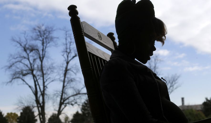 Local and federal law enforcement agencies are trying to do more to combat human trafficking. (AP Photo/Patrick Semansky)