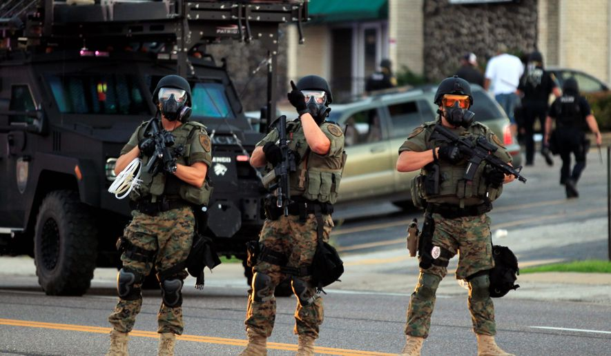 After critics decried Ferguson, Missouri, police using Defense Department-donated heavy artillery against rioting protesters, some law enforcement agencies are returning military-grade weaponry back to the Pentagon. (Associated Press)