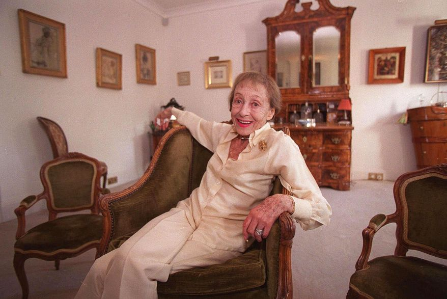 Actress Luise Rainer poses in her central London apartment in this July 29, 1999, file photo. Rainer, a star of cinema's golden era who won back-to-back Oscars but then walked away from a glittering Hollywood career, has died. She was 104. (AP Photo/Adam Butler, File)
