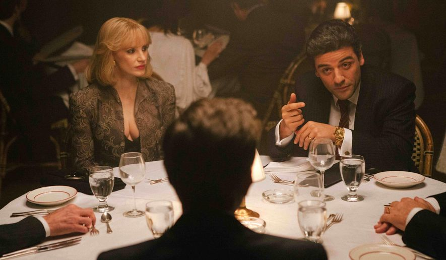 """In this image released by courtesy of A24, Jessica Chastain, left, and Oscar Isaac appear in a scene from the film, """"A Most Violent Year.""""  (AP Photo/A24, Atsushi Nishijima)"""