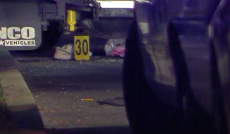 In this Dec. 30, 2014, photo taken from a video provided by WTXF Television, authorities investigate the scene after a man was shot and killed by police after he tried to use his car to run down officers seeking to arrest him in Upper Darby, Pa. The authorities said that the man had posted an online video threatening to kill police and FBI agents. (AP Photo/WTXF Television) MANDATORY CREDIT
