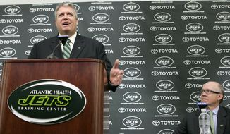 FILE- In this Jan. 21, 2009, file photo, New York Jets coach Rex Ryan, left, speaks as Jets owner Woody Johnson looks on during a news conference at the Jets training facility to introduce Ryan as the new Jets coach in Florham Park, N.J. Johnson fired Ryan and general manager John Idzik on Monday, Dec. 29, 2014, one day after one of the most disappointing seasons in franchise history. (AP Photo/Mike Derer, File)