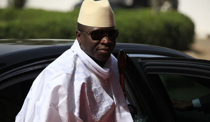 Gambia's President Yahya Jammeh arrives for a summit to address a seminar on security during an event marking the centenary of the unification of Nigeria's north and south in Abuja, Nigeria, in this Feb. 27, 2014, file photo. (AP Photo/Sunday Alamba, FILE)