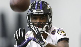 Baltimore Ravens wide receiver Torrey Smith catches a pass during an football practice Tuesday, Dec. 30, 2014, in Owings Mills, Md. The Ravens will travel to Pittsburgh for a wild-card game Saturday against the Steelers. (AP Photo/Patrick Semansky)