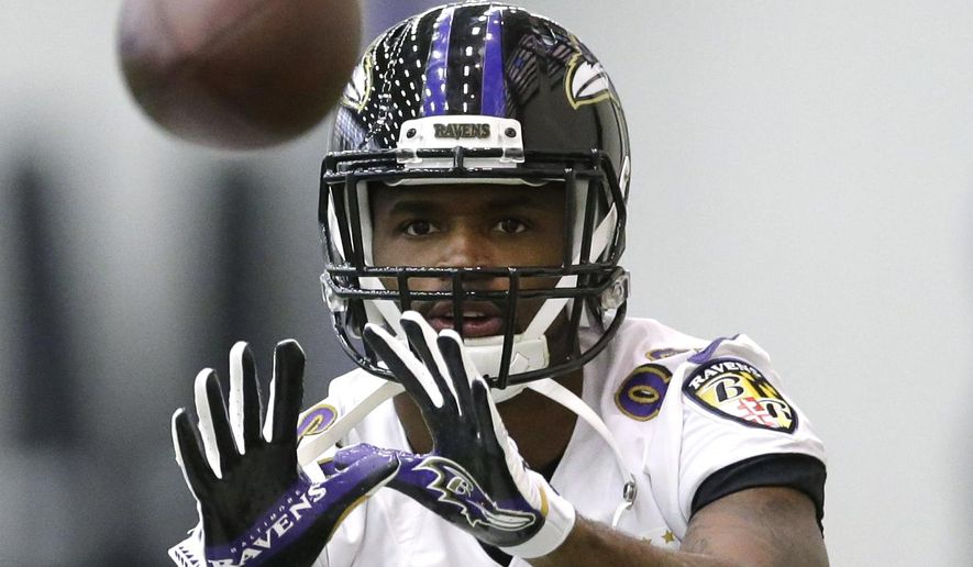Baltimore Ravens wide receiver Torrey Smith catches a pass during an football practice Tuesday, Dec. 30, 2014, in Owings Mills, Md. The Ravens will travel to Pittsburgh for a wild-card game Saturday against the Steelers. (AP Photo/Patrick Semansky) **FILE**