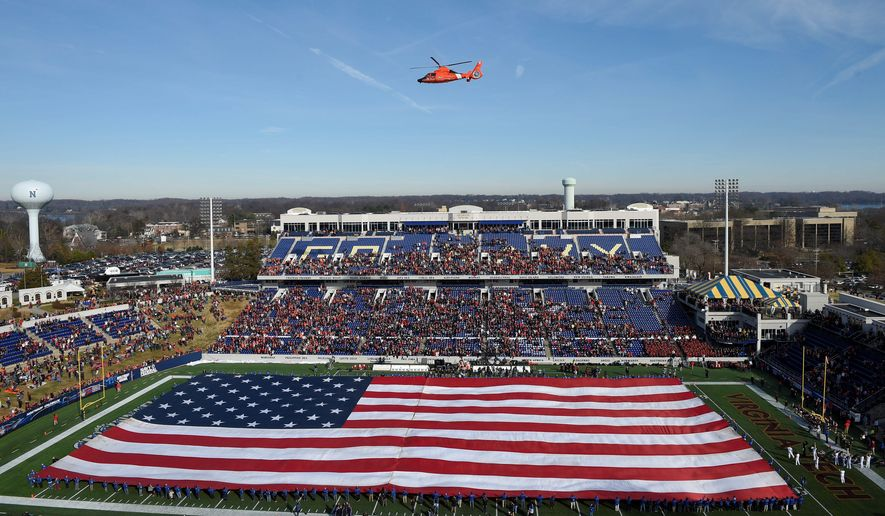 Critics say the Pentagon is spending too much taxpayer money on bombastic displays like sending aircraft to fly over stadiums, such as at last week's college football Military Bowl between Virginia Tech and Cincinnati in Annapolis. (Associated Press)