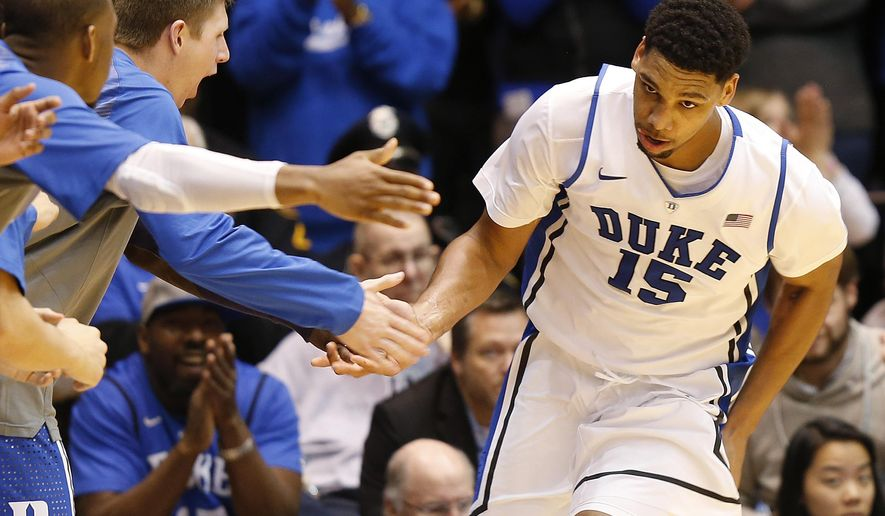 Duke's Jahlil Okafor (15) celebrates with teammates during the second half of an NCAA college basketball game against Toledo, Monday, Dec. 29, 2014 in Durham, N.C. (AP Photo/Ellen Ozier)