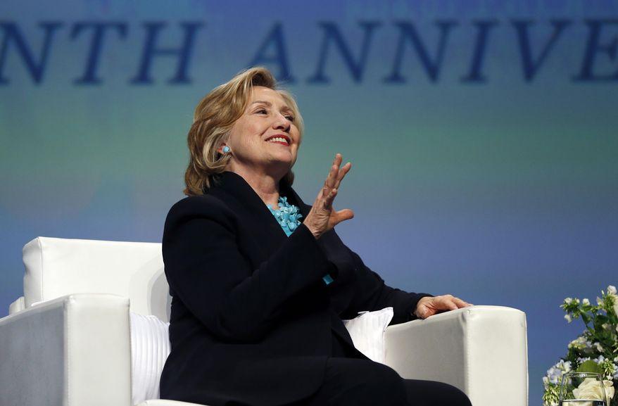 In this photo taken Dec. 4, 2014, former Secretary of State Hillary Rodham Clinton speaks in Boston. (AP Photo/Elise Amendola) ** FILE **