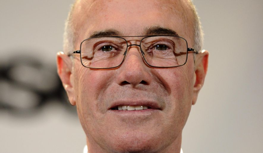 David Geffen, one of the winners of the Ahmet Ertegun Award, talks to the media in the press room at the Rock & Roll Hall of Fame induction ceremony in New York in this March 15, 2010, file photo. (AP Photo/Peter Kramer, File)