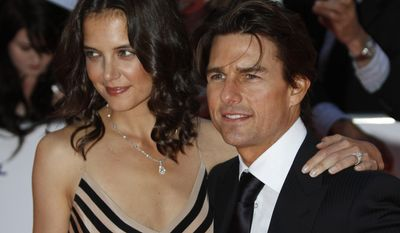 In this Wednesday, May 26, 2010 file photo US actor Tom Cruise, right, poses with his wife US actress Katie Holmes for the photographers as they arrive for the National Movie Awards at the Royal Festival Hall, in London. Holmes' attorney Jonathan Wolfe said Friday June 29, 2012 that the couple is divorcing, but called it a private matter for the family. ( AP Photo/Lefteris Pitarakis)
