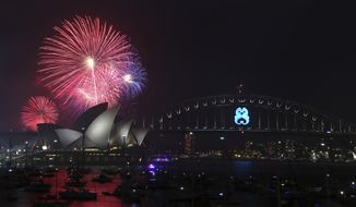 Fireworks explode over the Opera House and the Harbour Bridge during New Year's Eve celebrations in Sydney, Australia, Wednesday, Dec. 31, 2014. Thousands of people crammed into Lady Macquaries Chair to watch the annual fireworks show. (AP Photo/Rob Griffith)