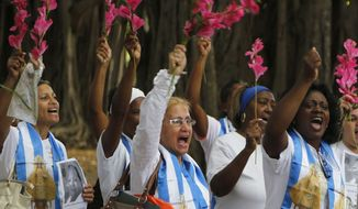 Members of the Ladies in White, a Cuban dissident group, participate in a demonstration Sunday in Havana. Cuban authorities have reportedly detained overnight dozens of pro-democracy and free speech activists this week, including at least three members of the nation's political opposition ahead of a planned protest art performance in Havana. (Associated Press)