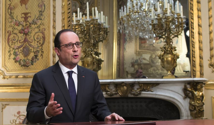 French President Francois Hollande, poses after addressing his New Year's wishes to the nation during a pre-recorded broadcast speech at the Elysee Palace, in Paris, Wednesday, Dec. 31, 2014. (AP Photo/Ian Langsdon, Pool)