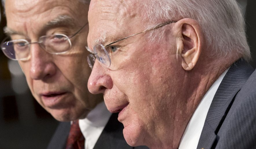 Sens. Patrick J. Leahy, Vermont Democrat (right), and Charles E. Grassley, Iowa Republican (left), asked about federal policy and the usage of simulator towers in a joint letter to Attorney General Eric H. Holder Jr. and Secretary of Homeland Security Jeh Johnson. (Associated Press)