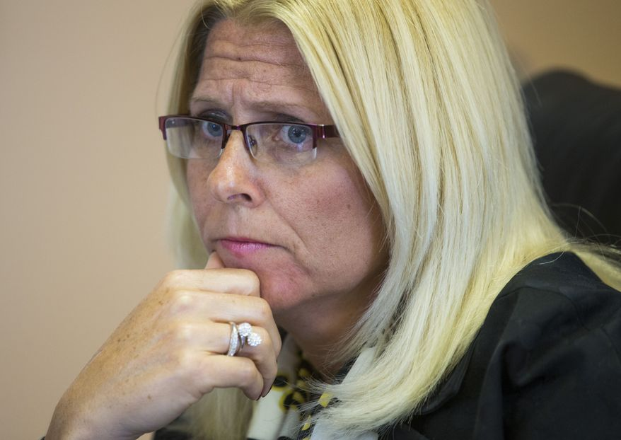 Sharon Helman, director of the Department of Veterans Affairs' Phoenix clinic, was fired from the VA, but only because she improperly took thousands of dollars in gifts. A personnel appeals judge last week rejected the VA's claim that she should also have been dismissed for overseeing the wait lists. (Associated Press)