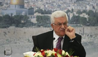 FILE - In this file photo taken Saturday, Jan. 11, 2014, Palestinian President Mahmoud Abbas speaks during a meeting at his compound in the West Bank city of Ramallah. Abbas said Wednesday, Dec. 31, that he is still weighing his options after a resounding defeat in the U.N. Security Council. But the Palestinian leader is hinting that he could join the International Criminal Court in the very near future - a move that would put him on a collision course with Israel. (AP Photo/Majdi Mohammed, File)