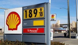 A sign shows the price of gasoline at a Shell station near downtown Detroit on Thursday, Jan. 1, 2015.  (AP Photo/David N. Goodman)