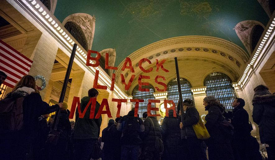 A group of protesters gather at Grand Central Terminal in New York, Thursday, Jan. 1, 2015. A number of protests have been staged around the country following recent grand jury decisions not to indict white police officers in New York and Ferguson, Mo., over the deaths of unarmed black men. (AP Photo/Craig Ruttle)