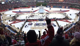 Fans cheer after the Washington Capitals defeated the Chicago Blackhawks 3-2 in the Winter Classic outdoor NHL hockey game at Nationals Park in Washington, Thursday, Jan. 1, 2015. (AP Photo/Susan Walsh)