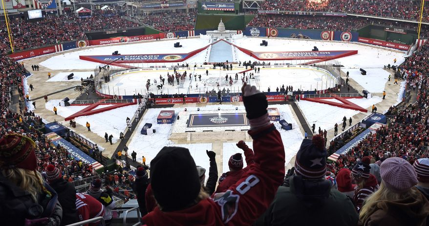3a3ebe10df465c Fans cheer after the Washington Capitals defeated the Chicago Blackhawks  3-2 in the Winter