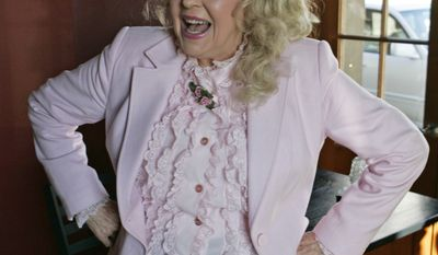 """This photo taken Jan. 8, 2009 shows Donna Douglas, who starred in the television series """"The Beverly Hillbillies"""" posing for a photograph in the photo taken in Baton Rouge, La. (AP Photo/Bill Haber)"""